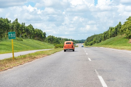 collisions: Cuba transport: Old vintage cars in the National Highway travelling at an approximate 100kmh.  Due to the lack of imports Cubans have become experts at innovating and keeping obsolete cars working.