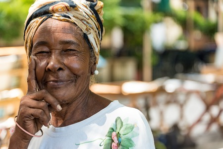 Cuban Afro Caribbean people: common woman in Old Havana. People are friendly and an attraction for photographer.  Old Havana is a Unesco World Heritage Site and a major tourist landmark in the Caribbean Island.
