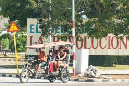 collisions: Havana city transportation in bicitaxi during the Raul Castro government: Bicycle taxis or rickshaws are common in the Cuban capital solving transportation needs of Cubans at a cheaper price.