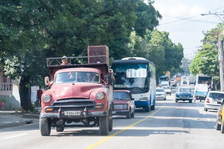 collisions: Havana city transportation during the Raul Castro government: Old obsolete vehicles transport passengers in the Cuban capital.  The lack of imports for years have forced the Cubans to innovate and keep obsolete cars running. Editorial