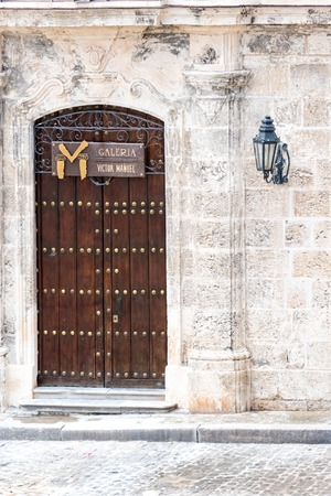 Old Havana, Cuba: Victor Manuel gallery entrance.  This gallery offers a nice selection of mainstream decorative modern paintings, some of which could be considered true works of art. Given its location and popularity, high prices are to be expected. Editorial