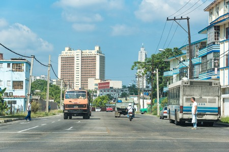 Havana city transportation during the Raul Castro government: Old obsolete vehicles transport passengers in the Cuban capital.  The lack of imports for years have forced the Cubans to innovate and keep obsolete cars running. Editorial