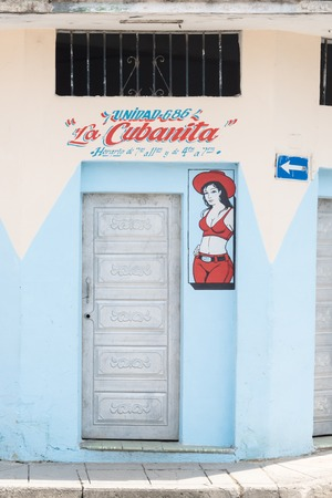 recently: Cuban bodega or grocery store in Santa Clara with La Cubanita written outside along with a portrait painting of a lady.  The bodega was recently revitalized where government sells subsidized or rationed food to the people. Editorial