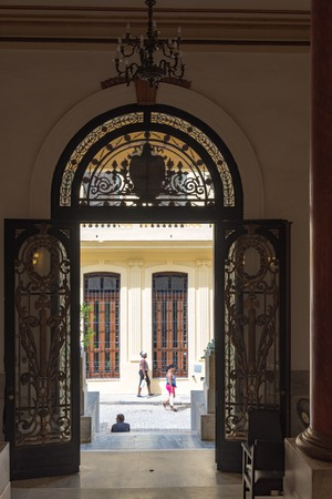 elaborate: Old Havana Palace of Government, Cuba. View of Cuban everyday life from the interior hall. The entrance door is very elaborate and beautiful Editorial