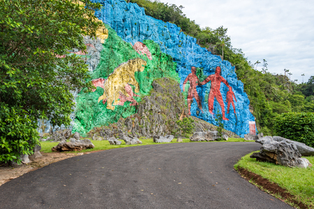 pinar: Vinales Valley in Pinar del Rio,Cuba is a Unesco World Heritage site since 1999 The Prehistory mural painted in the wall of a cliff is one of the popular attractions in the landmark
