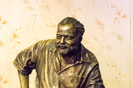 hemingway: Floridita, Havana,Cuba. Interior views, the bar specializing in Daiquiri cocktail is a major tourist attraction landmark in the city. Ernest Hemingway statue inside the premises Editorial
