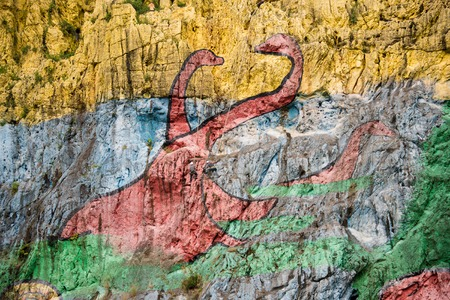 prehistory: Vinales Valley in Pinar del Rio,Cuba is a Unesco World Heritage site since 1999 The Prehistory mural painted in the wall of a cliff is one of the popular attractions in the landmark