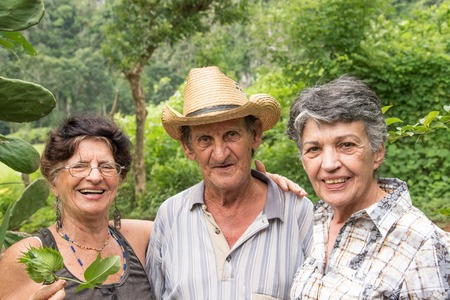 pinar: Vinales Valley in Pinar del Rio,Cuba is a Unesco World Heritage site Friendly inhabitants of the valley (couple to the left) and a visitor portrait (right) portrait.