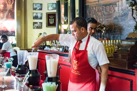 hemingway: Floridita, Havana,Cuba. Interior views, the bar specializing in Daiquiri cocktail is a major tourist attraction landmark in the city. Bartenders preparing Daiquiri cocktail inside the Floridita
