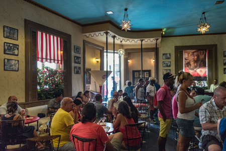 hemingway: Floridita, Havana,Cuba. Interior views, the bar specializing in Daiquiri cocktail is a major tourist attraction landmark in the city. Patrons enjoying drinks inside the popular bar