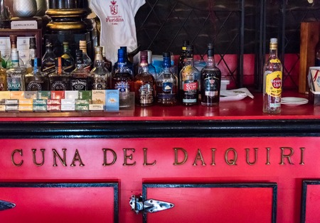 Floridita, Havana,Cuba. Interior views, the bar specializing in Daiquiri cocktail is a major tourist attraction landmark in the city. Old refrigerator reading the Cradle of Daiquiri