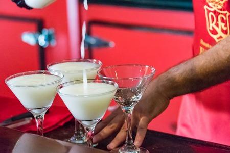 daiquiri: Floridita, Havana,Cuba. Interior views, the bar specializing in Daiquiri cocktail is a major tourist attraction landmark in the city. Pouring the Daiquiri Cocktail in glasses in the Floridita Bar