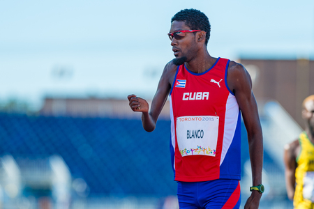 visually: Athletics in Toronto 2015 Parapan Am Games: Mr. Blanco representing Cuba enters first place in the track and field event.