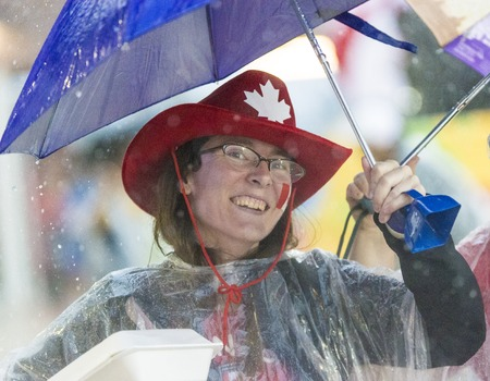 soggy: General Public in the Stands:Heavy rain kept most spectators under cover or away from the track entirely, the weather forecast also included lightning warnings during the opening day of Athletics in the Parapan Am Games in Toronto Editorial