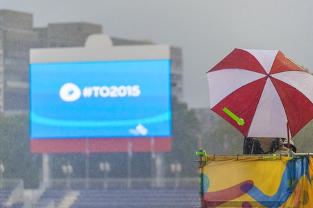 inclement: TV crew:Heavy rain kept most spectators under cover or away from the track entirely, the weather forecast also included lightning warnings during the opening day of Athletics in the Parapan Am Games in Toronto