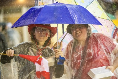 inclement: Spectators in the stands:Heavy rain kept most spectators under cover or away from the track entirely, the weather forecast also included lightning warnings during the opening day of Athletics in the Parapan Am Games in Toronto