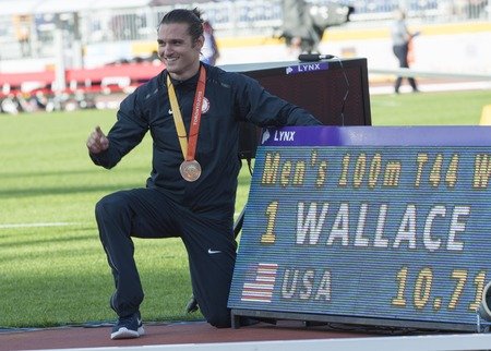world record: Darryd Wallace from the USA sets new World Record with 10.71 in Mens 100m T44 Final during the Toronto 2015 Parapan Am Games Editorial