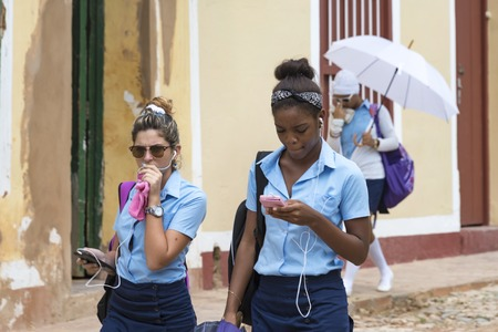 interned: Cuban high scool students in Trinidad, Cuba. After removing the interned schools, the high school students can be seen once more in their daily routine from home to school and viceversa.