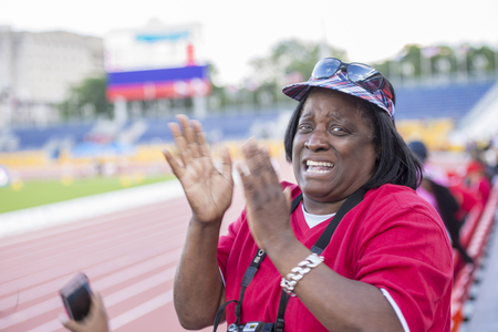 david brown: David Brown aunts shed a tear after her nephew sets a new Parapan Am Record timing 10.95 in the Mens 100m T11 Final. David wins the Gold Medal during the Parapan Am Games 2015 in Toronto. Editorial