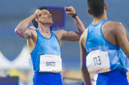 the americas: Hernan Barreto (left) sets new Americas Record and wins the first Gold Medal for Argentina in the Mens 100m T35 Final  during the Toronto Parapan Am Games