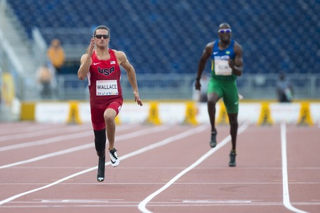 wallace: Darryd Wallace from the USA (left) sets new World Record with 10.71 in Mens 100m T44 Final during the Toronto 2015 Parapan Am Games Editorial