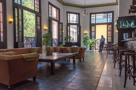 ernest hemingway: Ambos Mundos or Both Worlds hotel preferred by Ernest Hemingway when visiting Havana. The lobby features a collection of Hemigway photos and his framed signature. The hotel is in vintage colonial building in Old Havana and it is a major tourist landmark.