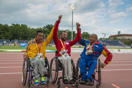 sarmiento: Brent Lakatos wins the Gold medal in the Mens 800m T53 Final during the Toronto 2015 Parapan Am Games. To his right, Edisson Andres Martinez Sarmiento from Colombia who won Silver. To Brents left, Jesus Aguilar from Venezuela who won the Bronze. Editorial