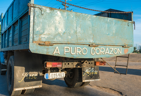cuban culture: Cuba road scenes, Rear view of truck with Pure Heart slogan written on it at Central Road Pure heart slogan in the original Cuban culture means something like the driver is brave or that he is working with no proper conditions Editorial