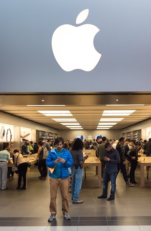 consumer electronics: Apple store: People visiting the Apple Store.The Apple Store is a chain of retail stores owned and operated by Apple Inc., dealing with computers and consumer electronics. Editorial