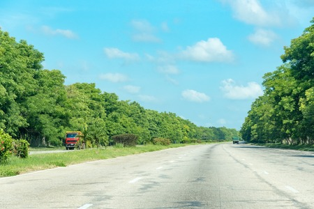 scenic drive: Open road Cuba National Highway from Santa Clara to Havana. Scenic drive in Cuba on the way to Havana.