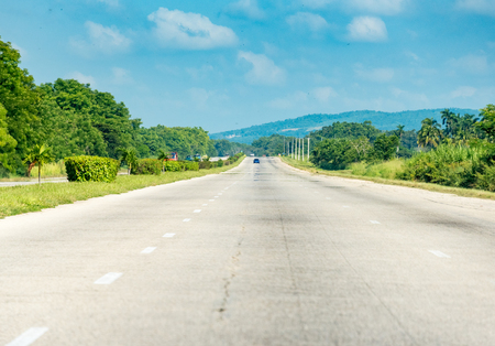 scenic drive: Open road in Cuba National Highway from Santa Clara to Havana. Scenic drive in the Cuba on the way to havana.