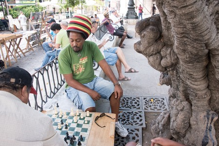 passtime: Cuban people playing chess on a plaza in Old Havana. Old Havana is a Unesco World Heritage site and a major tourist landmark in the Caribbean Island.