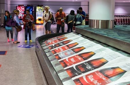 conveyor belt: Coca Cola advertisement in luggage conveyor belt at Pearson International Airport in Toronto,Canada