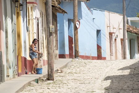 unesco world heritage site: Trinidad de Cuba, everyday lifestyle in the Hispanic colonial village which is stopped in time as a living museum of the sugar production golden era in the Caribbean Island.  Trinidad is a Unesco World Heritage Site.