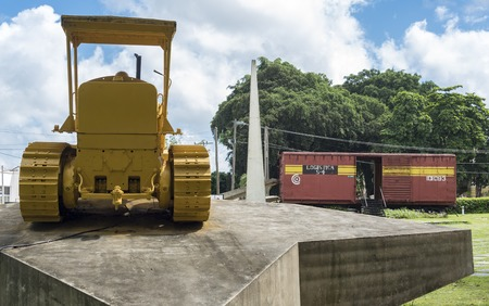 derail: Monument to the derailment of the armored train by Che Guevara led troops. Original caterpillar bulldozer used to break the rails, the dozer still  has bullet holes on its body