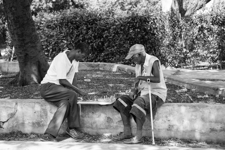 recreate: Cuban seniors playing chess in the street. Cubans like playing chess in public areas to pass time and recreate themselves in the Caribbean Island.