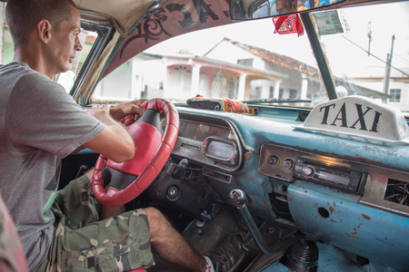 collisions: Cabin of an old American car working as private taxi in Cuba. Vintage cars in Cuba are both a tourist attraction and a road danger due to poor technical conditions