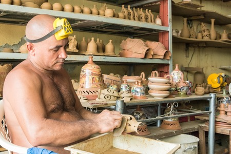 revitalization: Employees working in ceramic items in the Potter House or Casa del Alfarero run by Daniel Chichi Santander. The potter shop or taller del alfarero works on most of the reconstruction and revitalization projects for vintage buildings in the island. Editorial