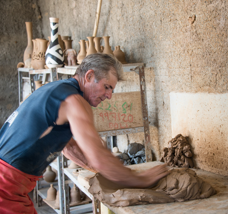 revitalization: Working the clay in the Potter House or Casa del Alfarero run by Daniel Chichi Santander. The potter shop or taller del alfarero works on most of the reconstruction and revitalization projects for vintage buildings in the island.