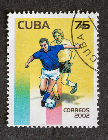 Postage stamp printed in Cuba used for mail, a series of stamps that were released in the year 2002 depicting soccer players playing in the field Stok Fotoğraf