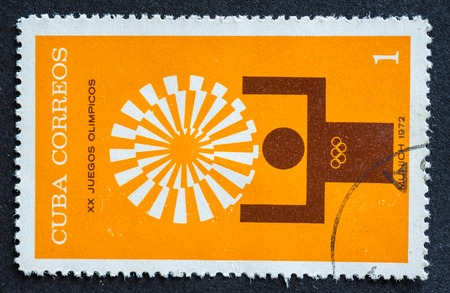 olympic sports: Stamps used for mail by Cuban citizens, a series devoted to depict sports played at the 1972 Olympic games held at Munich,  man displaying gold medal