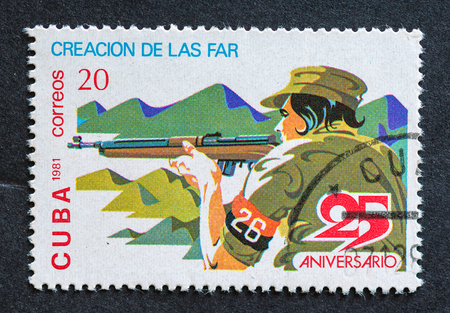 pivotal: Revolutionary soldier holding a rifle at the 26th of July, a pivotal moment in the Cuban Revolution for it was the day that the Revolutionary Armed Forces were deployed for the first time