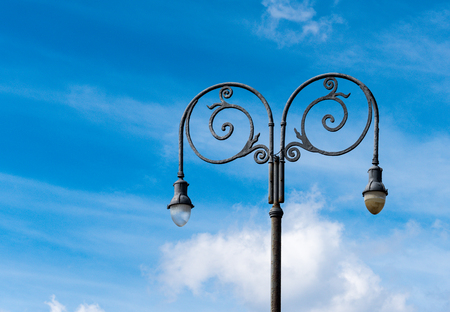 metal post: Malecon lightning system: Vintage black light post, curved metal design. Stock Photo