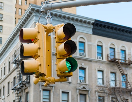 historic district: Manhattans traffic light on green. The traffic sign is in the Historic district of NY