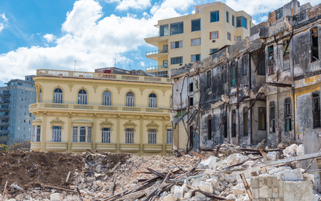 compared: Contrasts in rebuilding the Cuban capital. Destroyed building compared to a rebuilt one. Construction is important to attract tourism to the Cuban capital.
