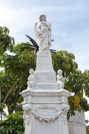 cristobal colon: Colon cementery: religion themed statues or sculptures made in white marble  The Cementerio de Colon landmark is among the five most important in the world. It contains many valuable sculpture and the tombs of many important Cuban personalities. Stock Photo