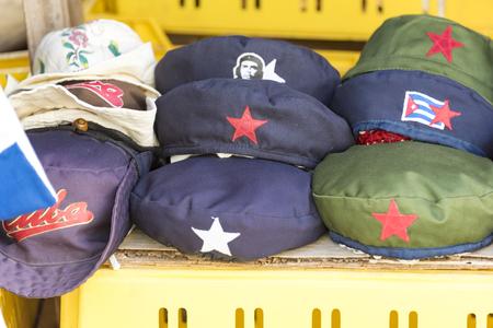berets: Local business kiosk selling Cuban souvenirs like Che Guevara berets, and farmers hats.
