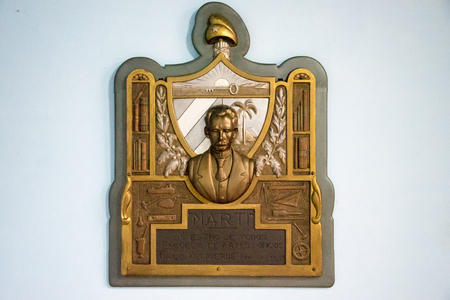 national hero: Golden Cuban coat of arms with Jose Marti ( National hero) in the center.