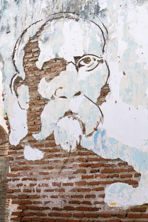 chiseled: Maximo Gomez portrait chiseled from brick wall