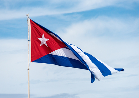red white blue: Colorful Cuban flag waiving high in the air, beautiful red, white, blue colors